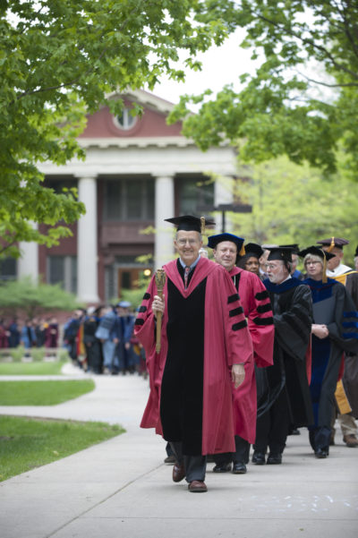 A line of professors in academic gowns
